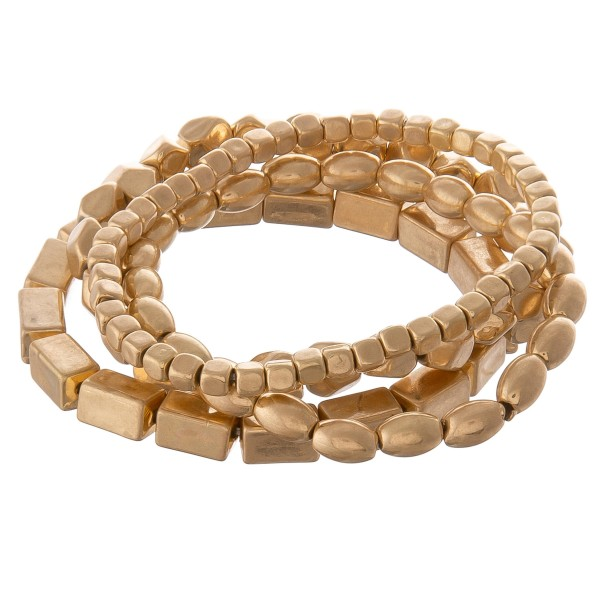 """Worn Gold beaded stackable stretch bracelet set.  - 4pcs/set - Approximately 3"""" in diameter unstretched - Fits up to a 7"""" wrist"""