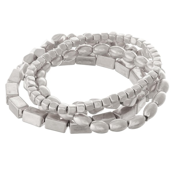 """Worn Silver beaded stackable stretch bracelet set.  - 4pcs/set - Approximately 3"""" in diameter unstretched - Fits up to a 7"""" wrist"""