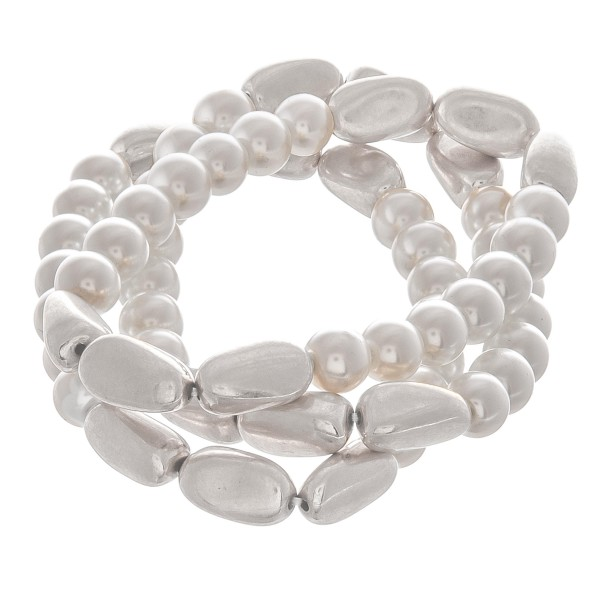 "Pearl beaded modern twist stretch bracelet set.  - 3pcs/pack - Approximately 3"" in diameter unstretched - Fits up to a 7"" wrist"