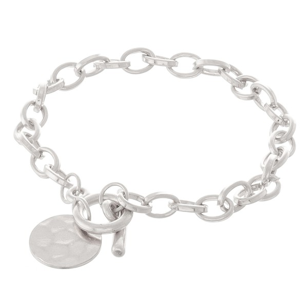"Hammered disc toggle bracelet.  - Toggle bar clasp  - Approximately 3"" in diameter - Fits up to a 6"" wrist"