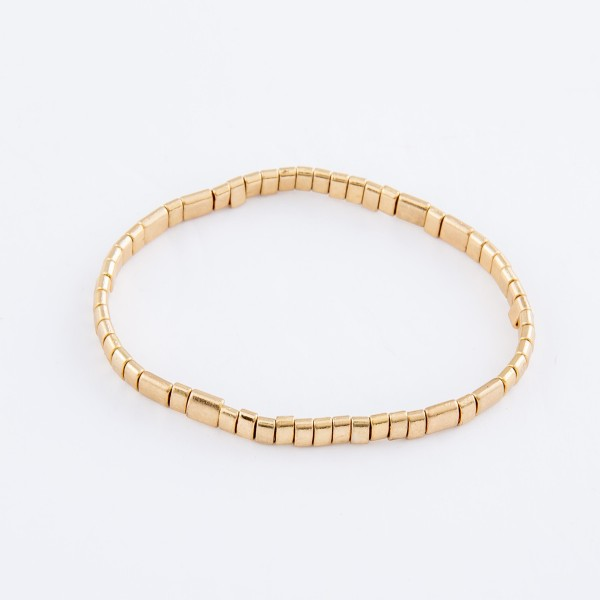"Miyuki Tila Bead Stretch Bracelet in Worn Gold.  - Approximately 3"" in diameter unstretched - Fits up to a 7"" wrist"