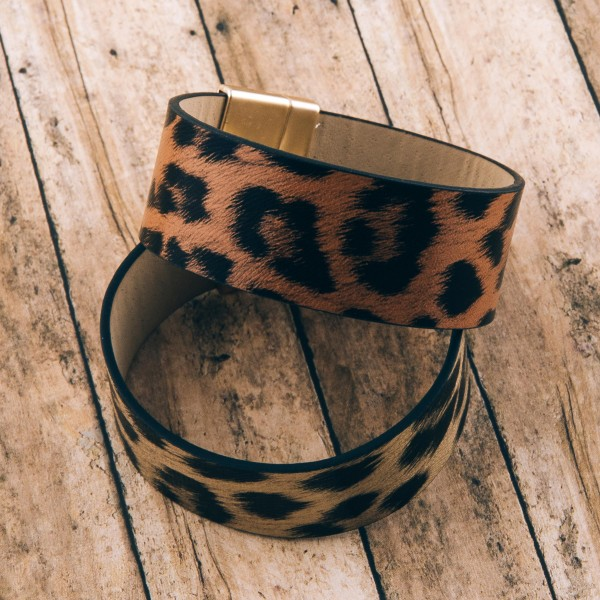 "Faux leather leopard print magnetic bracelet.  - Magnetic closure - Approximately 3"" in diameter - Fits up to a 6"" wrist - Approximately 1"" wide"