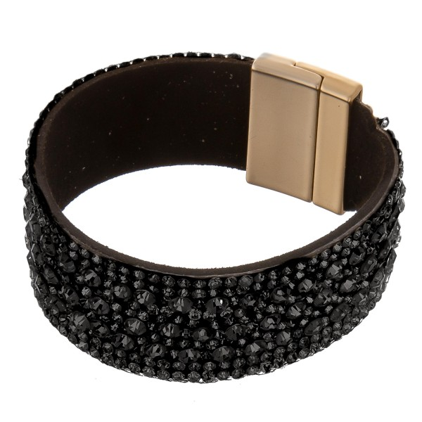 "Faux leather rhinestone cluster magnetic bracelet.  - Magnetic closure - Approximately 3"" in diameter - Fits up to a 6"" wrist - Approximately 1"" wide"