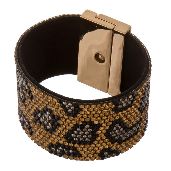 "Faux leather rhinestone leopard print turn lock bracelet.  - Turn Lock closure - Approximately 3"" in diameter - Fits up to a 6"" wrist - Approximately 1.5"" wide"