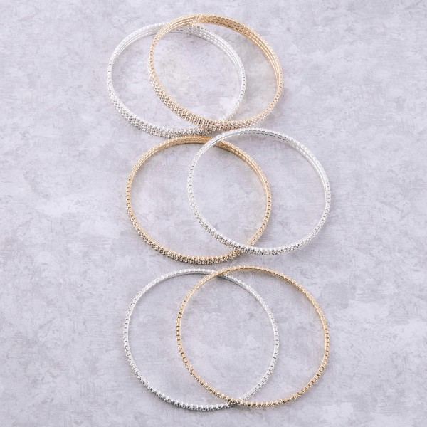 """Rhinestone bangle bracelet.  - One strand - Approximately 3"""" in diameter - Fits up to a 6"""" wrist"""