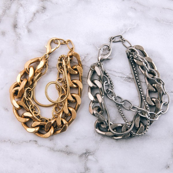 "Chunky multi strand curb chain link bracelet.  - Lobster clasp - Adjustable 1"" extender - Approximately 3"" in diameter - Fits up to an 8"" extender"