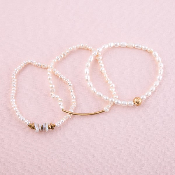 """Freshwater pearl beaded stretch bracelet with gold bead accent.  - Approximately 3"""" in diameter unstretched - Fits up to a 7"""" wrist"""