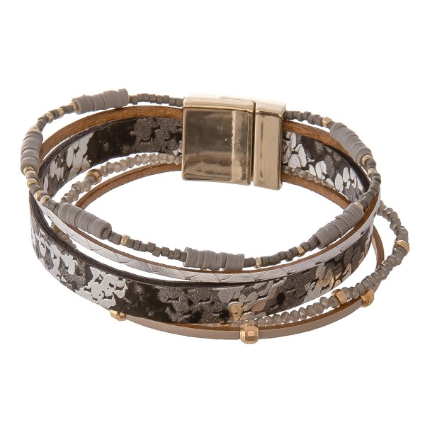 "Metallic faux leather snakeskin beaded magnetic bracelet.  - Magnetic closure - Approximately 3"" in diameter - Fits up to a 6"" wrist"