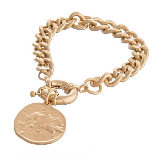 "Curb Chain Link Coin Bracelet in Worn Gold.  - Coin Charm 1""  - Approximately 3"" in diameter - Fits up to a 6"" wrist"