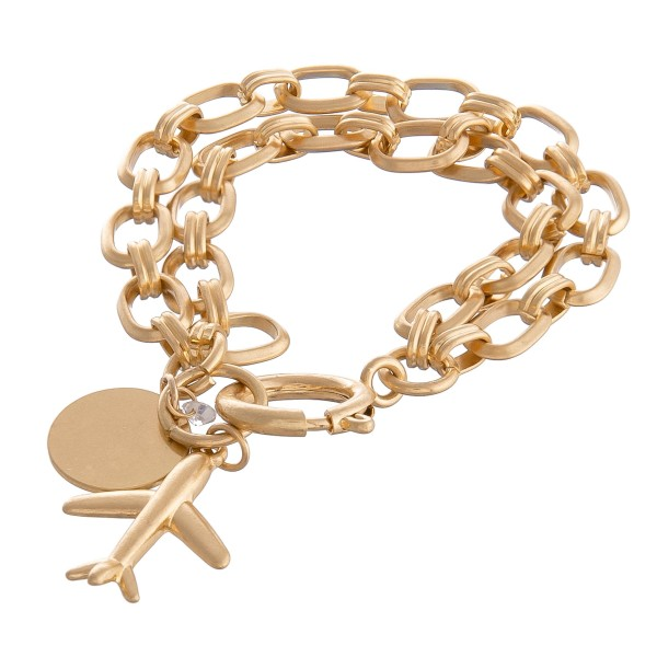 "Chain Link Layered Airplane Charm Bracelet in Worn Gold.  - Charm approximately 1"" - Approximately 3"" in diameter - Fits up to a 6"" wrist"
