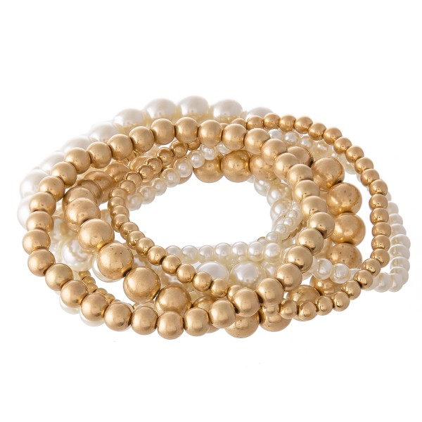 "Pearl Beaded Stackable Stretch Bracelet Set in Worn Gold.  - 8pcs/set - Approximately 3"" in diameter - Fits up to a 7"" wrist"