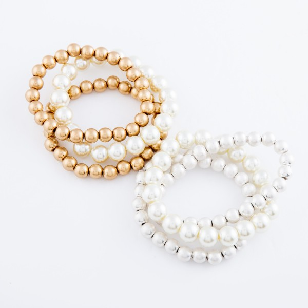 "Worn Pearl Beaded Stretch Bracelet Set.  - 3pcs/set - Bead Sizes- 7mm, 10mm - Approximately 3"" in diameter - Fits up to a 7"" wrist"