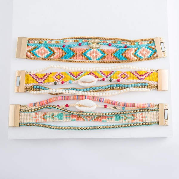 "Multi beaded loom puka shell cord magnetic bracelet.  - Magnetic closure - Approximately 3"" in diameter - Fits up to a 6"" wrist - Approximately 1"" wide"