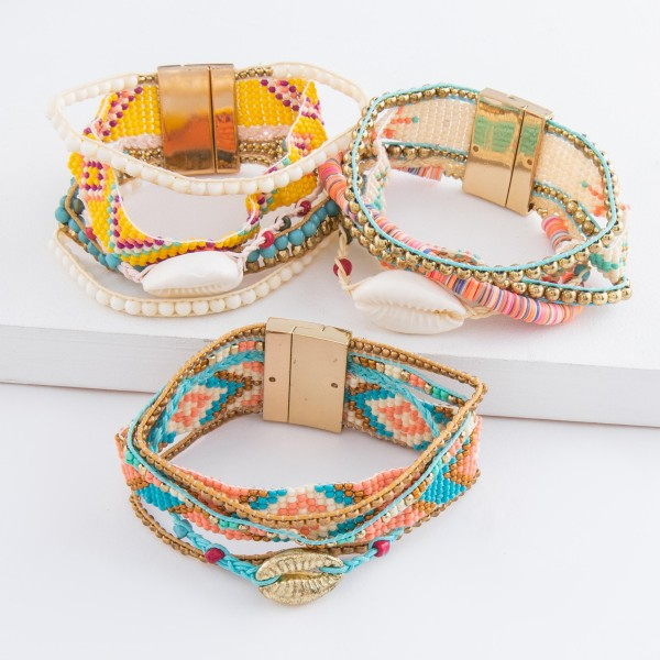 """Multi beaded loom puka shell cord magnetic bracelet.  - Magnetic closure - Approximately 3"""" in diameter - Fits up to a 6"""" wrist - Approximately 1"""" wide"""