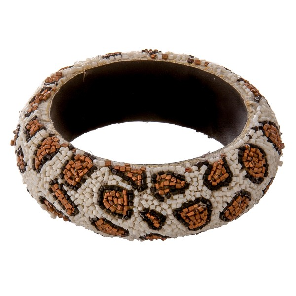 "Seed beaded leopard print statement bangle bracelet.  - Approximately 3"" in diameter - Fits up to a 6"" wrist"