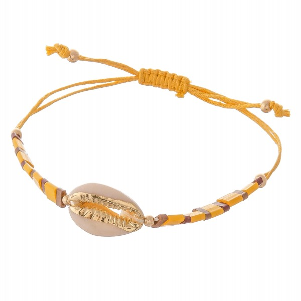 "Miyuki Tila beaded puka shell bolo cord bracelet.  - Ajustable bolo closure - Approximately 3"" in diameter - Fits up to an 8"" wrist"
