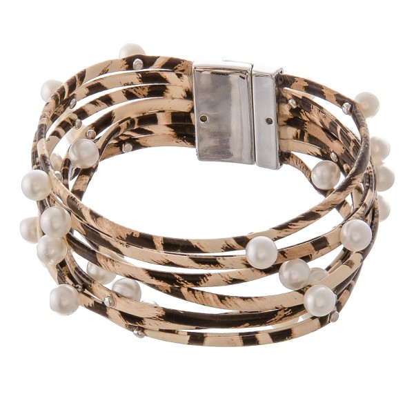 "Faux Leather Multi-Strand Animal Print Magnetic Bracelet Featuring Pearl Bead Details.  - Magnetic Closure - Approximately 3"" in Diameter - Fits up to a 6"" Wrist"