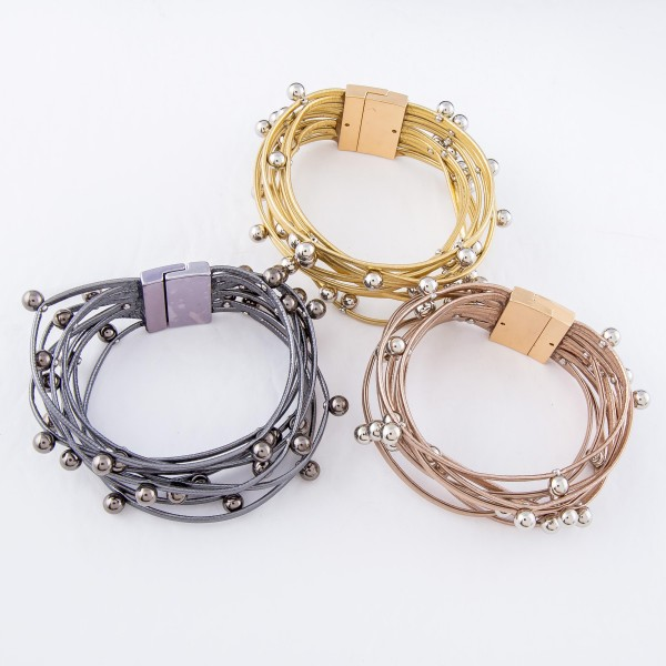 """Faux Leather Multi-Strand Magnetic Bracelet Featuring Ball Bead Details.  - Magnetic Closure - Approximately 3"""" in Diameter - Fits up to a 6"""" Wrist"""