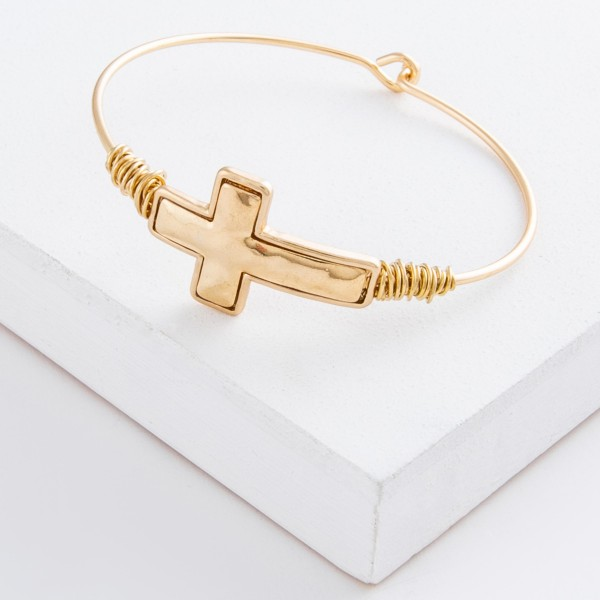 "East West Cross bangle bracelet with wire wrapped details.  - Hook closure - Focal approximately 1.25""  - Approximately 3"" in diameter - Fits up to a 6"" wrist"