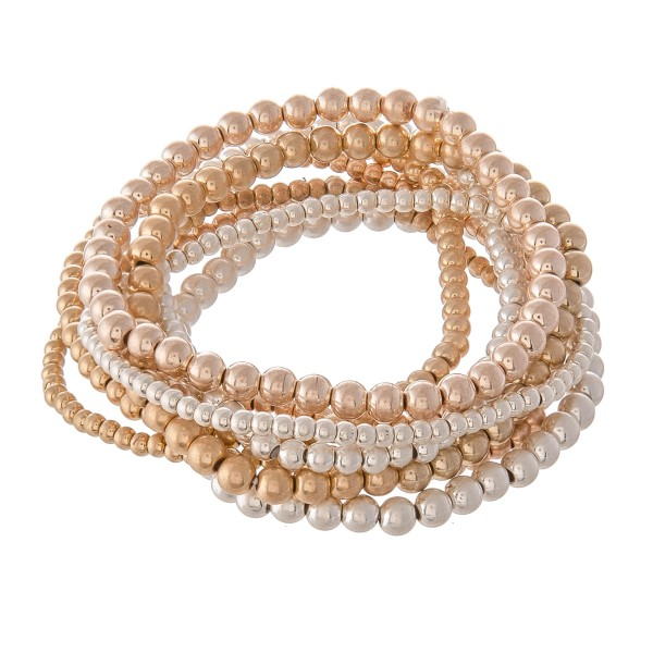 "Multi Tone Beaded Ball Stacking Stretch Bracelet Set.  - 9pcs/set - 2mm, 3mm, 4mm Bead Sizes - Approximately 3"" in diameter - Fits up to a 7"" wrist"