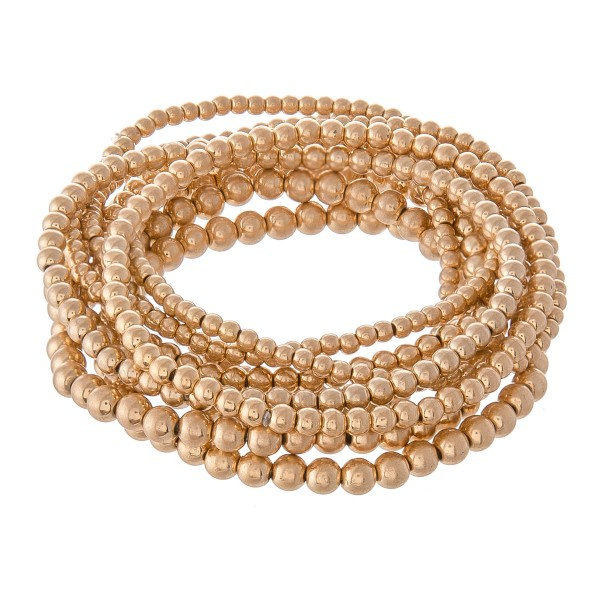 "Beaded Ball Stacking Stretch Bracelet Set in Worn Gold.  - 9pcs/set - 2mm, 3mm, 4mm Bead Sizes - Approximately 3"" in diameter - Fits up to a 7"" wrist"