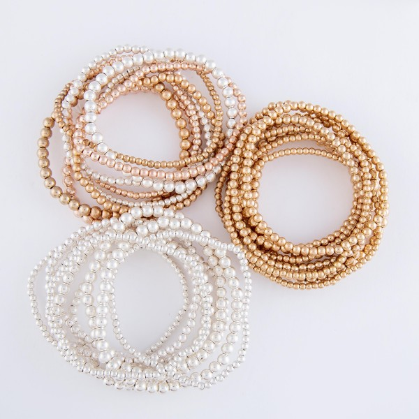 "Beaded Ball Stacking Stretch Bracelet Set in Worn Silver.  - 9pcs/set - 2mm, 3mm, 4mm Bead Sizes - Approximately 3"" in diameter - Fits up to a 7"" wrist"