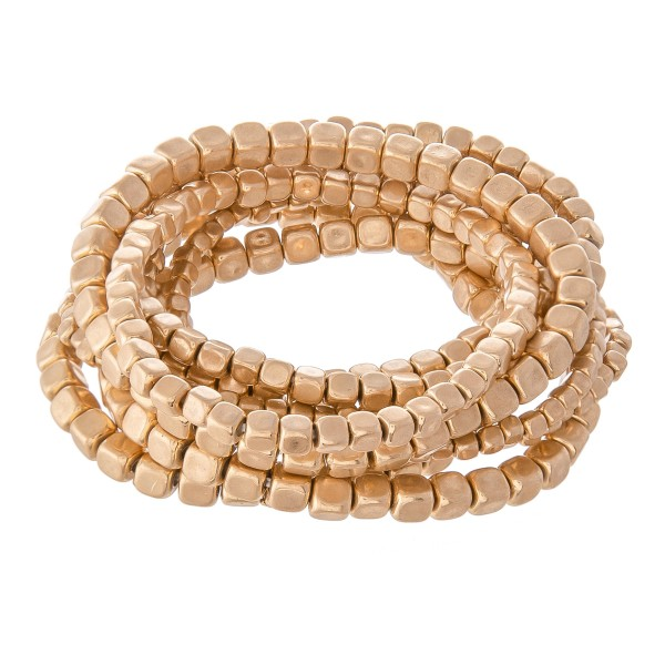 "Block Beaded Stacking Stretch Bracelet Set in Worn Gold.  - 9pcs/set - 2mm, 3mm, 4mm Bead Sizes - Approximately 3"" in diameter - Fits up to a 7"" wrist"