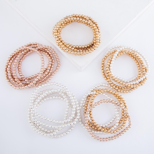 "Multi Tone Beaded Ball Stacking Bracelet Set.  - 5pcs/set - 3.5mm Bead Size - Approximately 3"" in diameter - Fits up to a 7"" wrist"