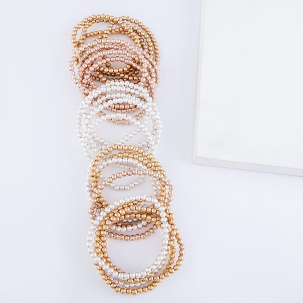 "Beaded Ball Stacking Bracelet Set in Worn Gold.  - 5pcs/set - 3.5mm Bead Size - Approximately 3"" in diameter - Fits up to a 7"" wrist"