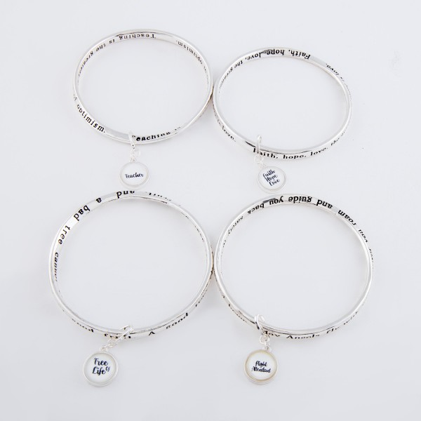 """Inspirational """"Tree of Life"""" dome charm bangle bracelet with message engraved details.  - Charm approximately .5"""" in diameter - Approximately 3"""" in diameter - Fits up to a 6 """" wrist"""