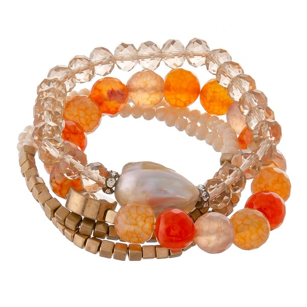 "Semi precious beaded pearl stretch bracelet set with gold accents.  - 4pcs/set - Approximately 3"" in diameter unstretched - Fits up to a 7"" wrist"