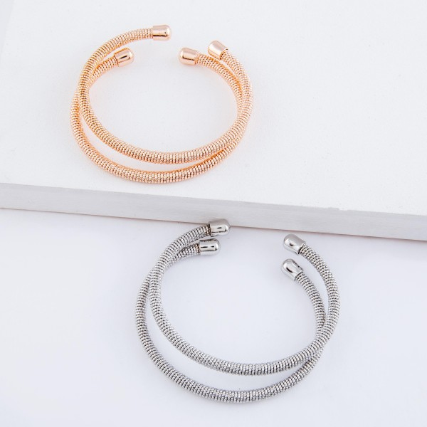 "Textured metal cuff bracelet set.  - 2pcs/set - Approximately 3"" in diameter - Fits up to a 6"" wrist"