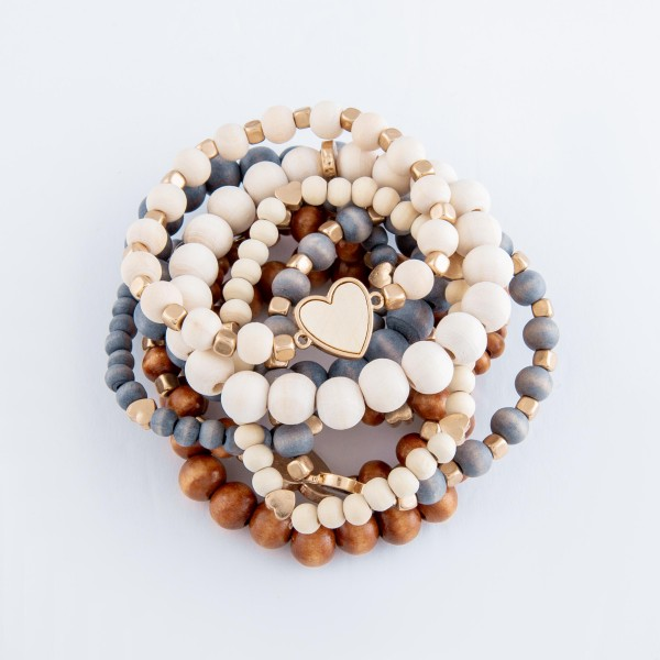 """Wood beaded heart stretch bracelet set.  - 3pcs/set - Approximately 3"""" in diameter - Fits up to a 7"""" wrist"""