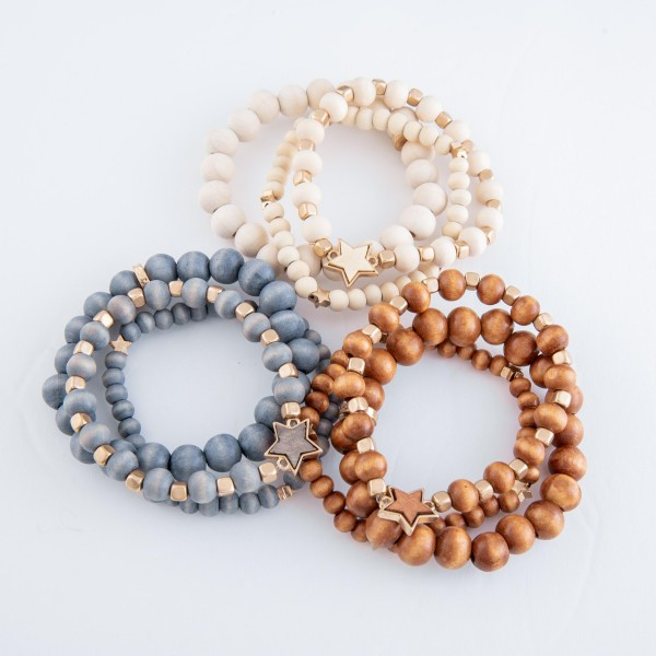 """Wood beaded star stretch bracelet set.  - 3pcs/set - Approximately 3"""" in diameter - Fits up to a 7"""" wrist"""