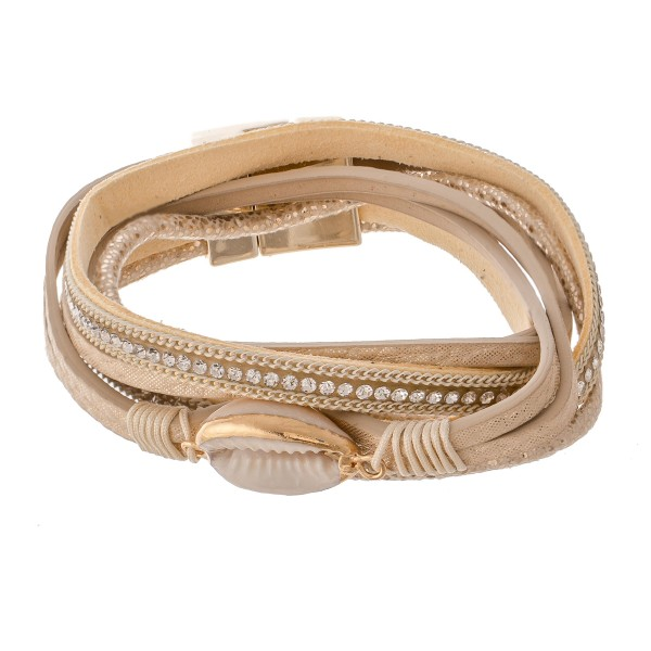 "Beige faux leather rhinestone puka shell wrap magnetic bracelet.  - Magnetic closure - Approximately 3"" in diameter - Fits up to a 6"" wrist"
