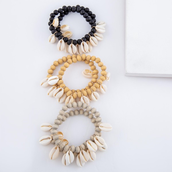 "Wood Beaded Puka Shell Charm Stretch Bracelet Set.  - 2pcs/set - Approximately 3"" in diameter - Fits up to a 7"" wrist"