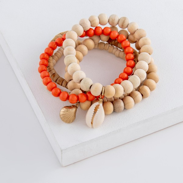 """Wood beaded puka shell charm stretch bracelet set.  - 5pcs/set - Approximately 3"""" in diameter unstretched - Fits up to a 7"""" wrist"""
