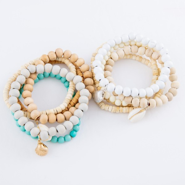 "Wood Heishi Beaded Shell Charm Stretch Bracelet Set.  - 5pcs/set - Approximately 3"" in diameter unstretched - Fits up to a 7"" wrist"
