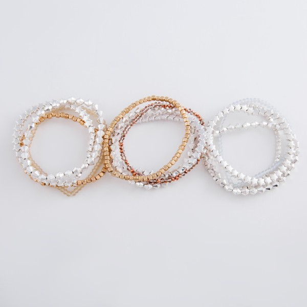 "Metal Tone Star Beaded Stretch Bracelet Set with Faceted Details.  - 4pcs/set - Approximately 3"" in diameter unstretched - Fits up to a 7"" wrist"