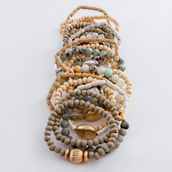 """Wood beaded natural stone stretch bracelet set with gold accents.  - 4pcs/set - Approximately 3"""" in diameter unstretched - Fits up to a 7"""" wrist"""
