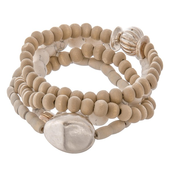 "Wood beaded natural stone stretch bracelet set with silver accents.  - 4pcs/set - Approximately 3"" in diameter unstretched - Fits up to a 7"" wrist"