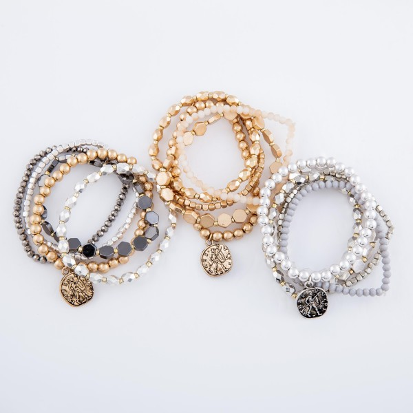"""Metal Tone Honeycomb Coin Charm Stretch Bracelet Set.  - 5pcs/set - Approximately 3"""" in diameter - Fits up to a 7"""" wrist"""