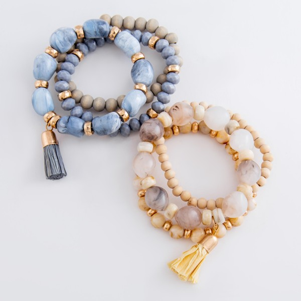 "Natural stone glass beaded stretch bracelet set with raffia tassel.  - 3pcs/set - Approximately 3"" in diameter unstretched - Fits up to a 7"" wrist"
