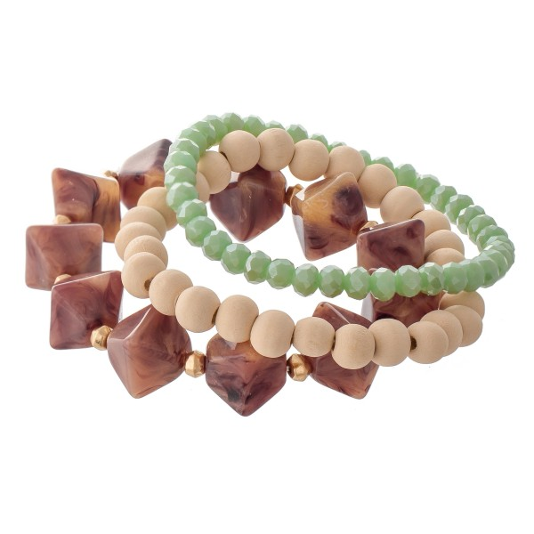 "Natural Stone Wood Beaded Stretch Bracelet Set with Mint Faceted Details.  - 3pcs/set - Approximately 3"" in diameter - Fits up to a 7"" wrist"