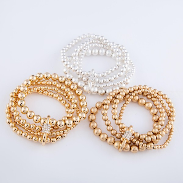 "CCB Beaded Rhinestone Carabiner Stacking Stretch Bracelet Set in Worn Gold.  - 4pcs/set - 3mm, 5mm, 7mm Bead Sizes - Approximately 3"" in diameter - Fits up to a 7"" wrist"