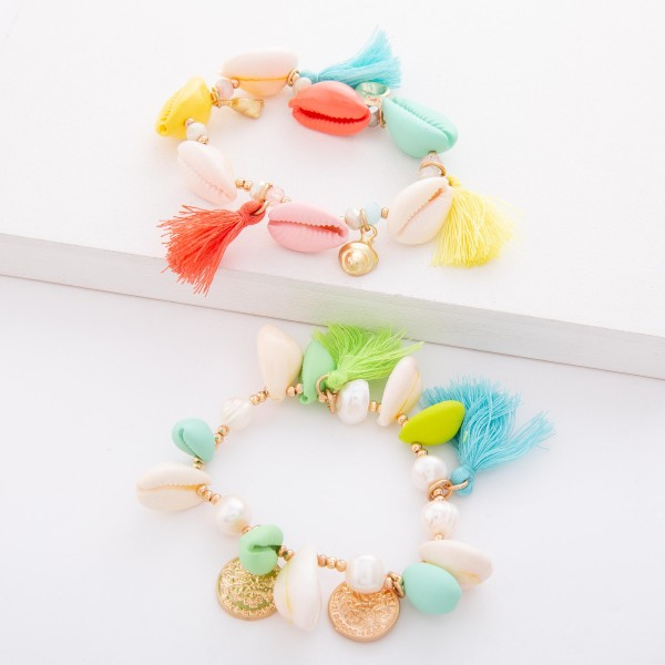 "Lime Enamel Coated Puka Shell Coin Tassel Stretch Bracelet with Pearl Accents.  - Approximately 3"" in diameter unstretched - Fits up to a 7"" wrist"