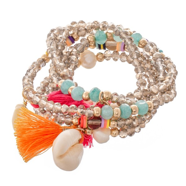 """Beaded Puka Shell Tassel Wrap Stretch Bracelet with Pearl Accents.  - Approximately 3"""" in diameter unstretched - Fits up to an 8"""" wrist"""
