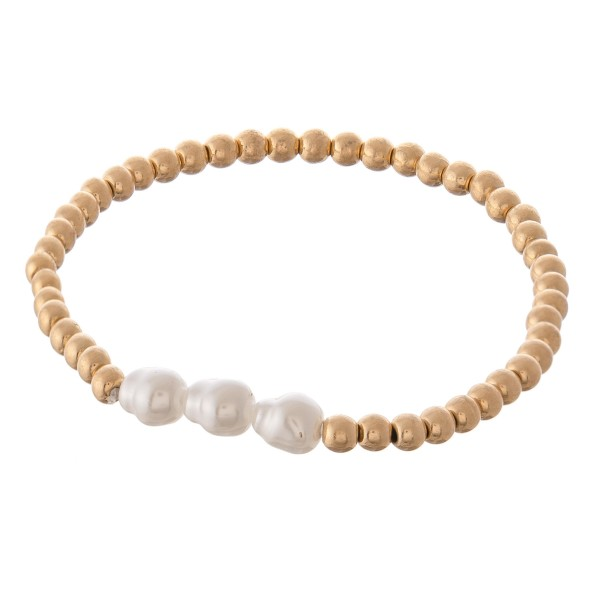 "Worn Gold beaded triple baroque pearl stretch bracelet.  - Approximately 3"" in diameter - Fits up to a 7"" wrist"