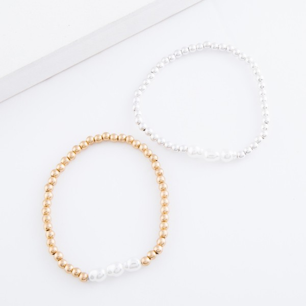 """Worn Gold beaded triple baroque pearl stretch bracelet.  - Approximately 3"""" in diameter - Fits up to a 7"""" wrist"""