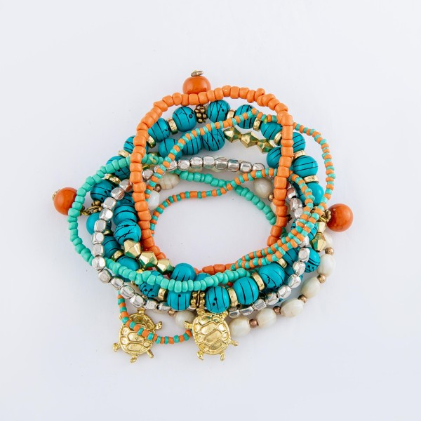 """Turquoise Spatter Beaded Sea Turtle Charm Stacking Stretch Bracelet Set.  - 8pcs/set - Approximately 3"""" in diameter  - Fits up to a 7"""" wrist"""
